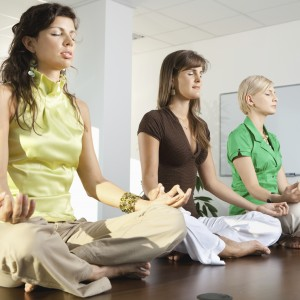 Buinesswomen sitting in lotus position